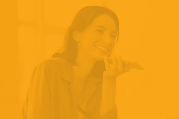 Yellow overlay over a woman talking on the phone