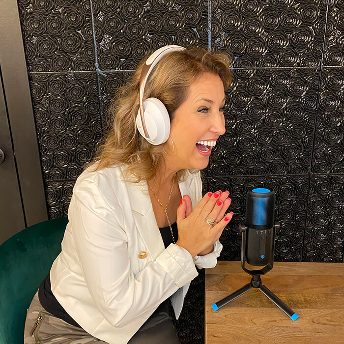 Shannon - the co-founder of HipCat Society - speaking into a microphone